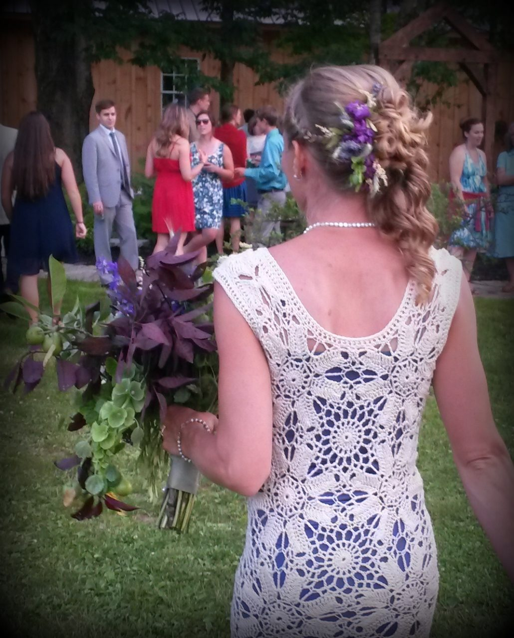 Crocheted dress, cascading bouquet, and hair piece!